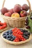 Blueberries, currants and blackberries basket — Stock Photo