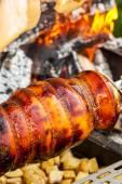 Cooking pork on spit — Stockfoto