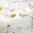 Wedding rings on a white cloth — Stock Photo #58769691