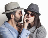 Gangster couple smoking — Stockfoto