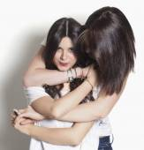Sisters smiling and hugging — Stock Photo