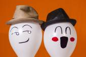 Balloon characters wearing hats — Stock Photo