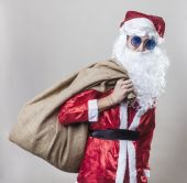 Santa Claus carrying a jute sack — Stok fotoğraf