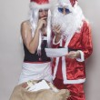 Beautiful girl and Santa Claus reading a Christmas letter 2 — Stock Photo #58363529