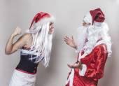 Joking girl against Santa Claus — Stock Photo