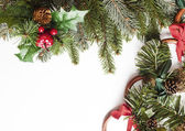 Blank Christmas card with pine needles and decorations — Stock Photo