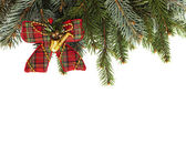 Blank Christmas card with pine needles and decorative bow vertic — Stock Photo