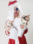 Angry Santa Claus unwrapping a gift — Stock Photo
