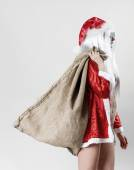 Santa Claus holding a jute sack and going to work — Stock Photo