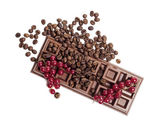 Chocolate bar with red currant and coffee beans — Stock Photo
