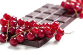Dark chocolate bar with red currant — Stock Photo