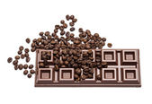 Milk chocolate bar with coffee beans — Stock Photo