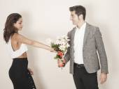 Woman accepting a bouquet from her date — Stock Photo