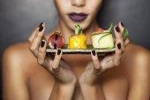 Beautiful model holding japanese traditional food — Stock Photo