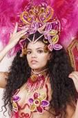 Beautiful samba dancer wearing pink costume and looking — Stockfoto
