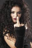 Rocker girl making middle finger gesture and looking closeup — Stock Photo