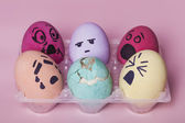 Bunch of painted eggs reacting to dead broken egg — Stock Photo