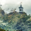 Double exposure of clock tower and clouds — Stock Photo #66230601