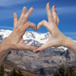 Double exposure of heart gesture and mountains — Stock Photo #66231985