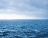 Blue sea landscape and overcast sky — Stock Photo