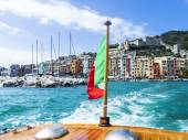 Cinque Terre glimpse in Liguria from watercraft and italian flag — Stock Photo