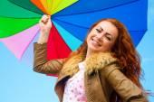 Portrait of a pretty woman with colorful umbrella — Stock Photo