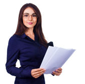 Business woman holding reports and looking at camera, isolated over white — Stock Photo