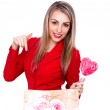 Smiling young woman with heart shaped lollipop and present bag on white — Stock Photo #64708139