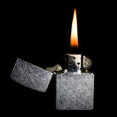Silver metal zippo lighter isolated on black background — Stock Photo