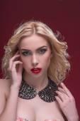 Wonderful blonde wearing jewelry — Stock Photo