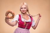 Young sexy blonde wearing dirndl — Stock Photo