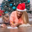 Mom and daughter waiting for Christmas — Stock Photo #56657443