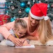 Mom and daughter waiting for Christmas — Stock Photo #56658195
