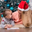 Mom and daughter waiting for Christmas — Stock Photo #56659475