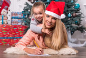 Mom and daughter waiting for Christmas — Stock Photo