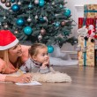 Mom and daughter waiting for Christmas — Stock Photo #56661095