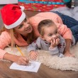 Mom and daughter waiting for Christmas — Stock Photo #56661565