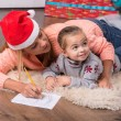 Mom and daughter waiting for Christmas — Stock Photo #56661885