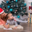 Mom and daughter waiting for Christmas — Stock Photo #56691629