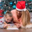 Mom and daughter waiting for Christmas — Stock Photo #56691633