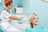 Work of dentist is not so easy — Stock Photo