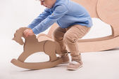 Child with the toy horse — Stock Photo