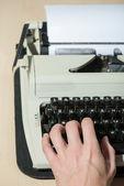 Working at the typewriter close up — 图库照片