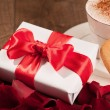 Closeup image of present and cup coffee — Stock Photo #62636455