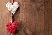 Hearts hanging on wooden wall — Stockfoto