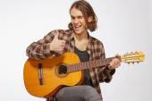Young guitar player singing a song — Stock Photo
