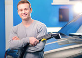 Handsome man cleaning his car — Stock Photo