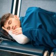 Handsome man in the airport — Stock Photo #65476023