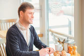 Handsome young man in cafe — Foto de Stock
