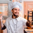 Handsome cook in the kitchen — Stock Photo #65480903